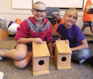Josie and Jessica with birdhouses for web